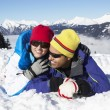 Couple Having Fun On Ski Holiday In Mountains - Stockfoto
