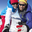 Couple Having Fun On Ski Holiday In Mountains - Stock Photo