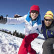 Couple Having Fun On Ski Holiday In Mountains — Stock Photo #11892518