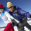 Couple Having Fun On Ski Holiday In Mountains — Stock Photo #11892520