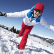 Woman Having Fun On Ski Holiday In Mountains — Stock Photo #11892522