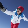 Woman Having Fun On Ski Holiday In Mountains — Stock Photo #11892525