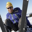 Stock Photo: Male Skier Sitting In Snow With After Fall