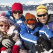 Family Having Fun On Ski Holiday In Mountains — Foto de Stock