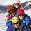 Family Having Fun On Ski Holiday In Mountains — Stock Photo
