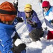 Family Having Snowball Fight On Ski Holiday In Mountains — Stock Photo #11892538