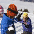 Stock Photo: Family Having Snowball Fight On Ski Holiday In Mountains