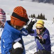 Family Having Snowball Fight On Ski Holiday In Mountains — Stock Photo #11892541