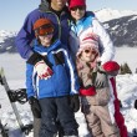 Family On Ski Holiday In Mountains — Stock Photo #11892543