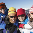Family Having Fun On Ski Holiday In Mountains - Stock Photo