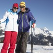 Couple Having Fun On Ski Holiday In Mountains — Stock Photo #11892552