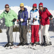 Group Of Middle Aged Couples On Ski Holiday In Mountains — Stock Photo #11892557