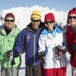 Group Of Middle Aged Couples On Ski Holiday In Mountains — Stock Photo #11892566