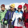 Group Of Middle Aged Couples On Ski Holiday In Mountains — Stock Photo #11892568
