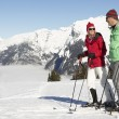 Couple Having Fun On Ski Holiday In Mountains — Stock Photo #11892570