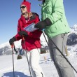 Couple Looking At Map Whilst On Ski Holiday In Mountains — Stock Photo #11892580
