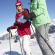 Couple Looking At Map Whilst On Ski Holiday In Mountains — Stock Photo #11892583
