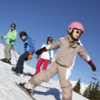 Stock Photo: Family On Ski Holiday In Mountains