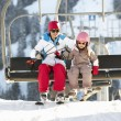Royalty-Free Stock Photo: Mother And Daughter Getting Off chair Lift On Ski Holiday In Mou