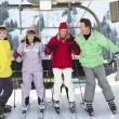 Royalty-Free Stock Photo: Teenage Family Getting Off chair Lift On Ski Holiday In Mountain