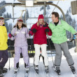 Stock Photo: Teenage Family Getting Off chair Lift On Ski Holiday In Mountain
