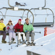 Teenage Family Getting Off chair Lift On Ski Holiday In Mountain — Foto de Stock