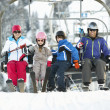 Family Getting Off chair Lift On Ski Holiday In Mountains — Stock fotografie
