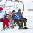 Family Getting Off chair Lift On Ski Holiday In Mountains — Stock Photo