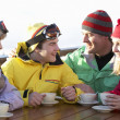 Teenage Family Enjoying Hot Drink In Café At Ski Resort — Stock Photo