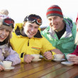 Teenage Family Enjoying Hot Drink In Café At Ski Resort — Stock Photo #11892693