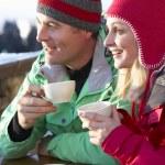 Couple Enjoying Hot Drink In Café At Ski Resort — Stock Photo #11892706