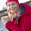 Woman Enjoying Hot Drink In Café At Ski Resort — Stock Photo
