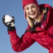 Stock Photo: WomAbout To Throw Snowball Wearing Warm Clothes On Ski Holida