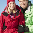 Couple Standing In Snow Wearing Warm Clothes On Ski Holiday In M — Stock Photo #11892906