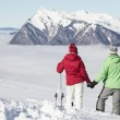 Couple Admiring Mountain View Whilst On Ski Holiday In Mountains — Stock Photo