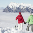 Stock Photo: Couple Admiring Mountain View Whilst On Ski Holiday In Mountains