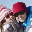 Stock Photo: Mother And Daughter Having Fun On Ski Holiday In Mountains