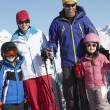 Family On Ski Holiday In Mountains — Stock Photo #11893032