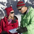 Couple Looking At Map Whilst On Ski Holiday In Mountains — Stock Photo