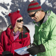 Couple Looking At Map Whilst On Ski Holiday In Mountains — Stock Photo #11893071
