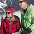 Couple Looking At Map Whilst On Ski Holiday In Mountains — Stock Photo #11893076