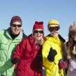 Teenage Family On Ski Holiday In Mountains — Stock Photo #11893082
