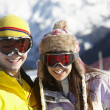 Stock Photo: Two Teenagers On Ski Holiday In Mountains