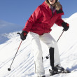 Woman On Ski Holiday In Mountains - Stock Photo