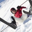 Female Skier Sitting In Snow With After Fall — Stock Photo #11893121