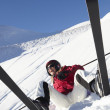 Female Skier Sitting In Snow With After Fall — Stock Photo #11893127