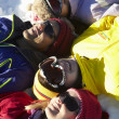 Overhead View Of Teenage Family Lying In Snow On Ski Holiday In — Stock Photo #11893143