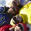 Overhead View Of Teenage Family Lying In Snow On Ski Holiday In — Stock Photo