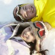 Overhead View Of Two Teenagers On Ski Holiday In Mountains — Stock Photo #11893165