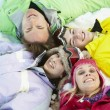 Overhead View Of Teenage Family Lying In Snow On Ski Holiday In — Stock Photo #11893172